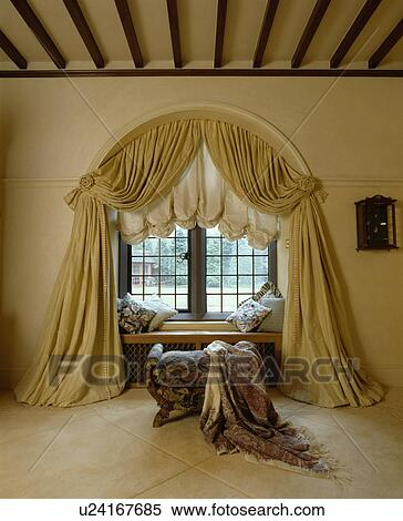 Stock Image   Swagged Curtains And Ruched Blind On Arched Window.  Fotosearch   Search Stock