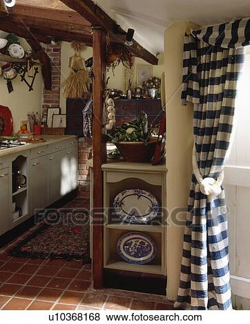 Pictures of Blue+white checked curtain at door in cottage kitchen ...