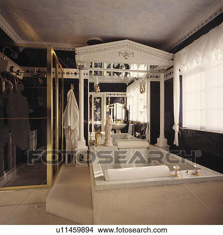 Stock Photo of Large rectangular marble bath below pillars with pediment in black+white neo ...