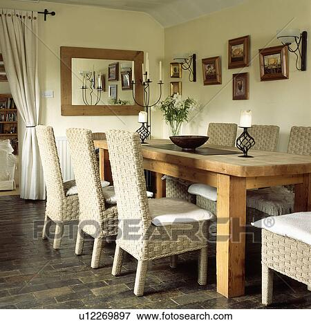 highbacked seagrass chairs and rustic wooden table in cream cottage dining room - Seagrass Chairs