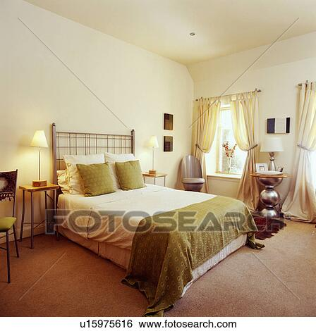 Green Curtains brown cream and green curtains : Stock Images of Green cushions and throw on bed in cream bedroom ...
