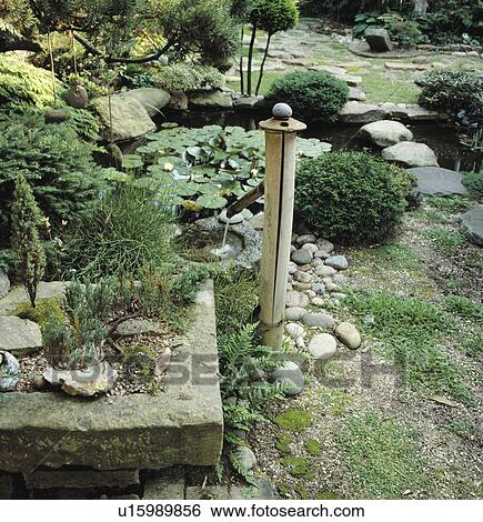Stock images of japanese bamboo water feature in oriental for Bamboo water garden