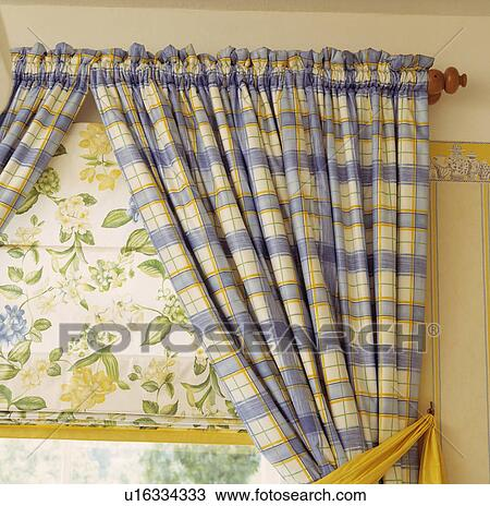 Stock Photo of Close-up of blue+yellow checked curtains and yellow ...