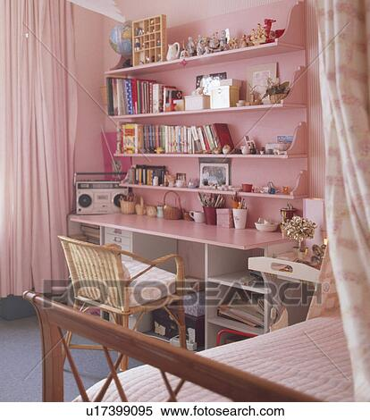 Stock Image Of Books And Knick Knacks On Pink Shelves