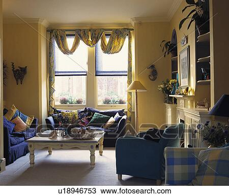 Stock photo of traditional yellow living room with blue for Traditional armchairs for living room