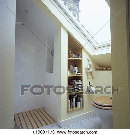 Stock Photo   Velux Window Above Toilet In Small Attic Bathroom With Open  Shower And Recessed