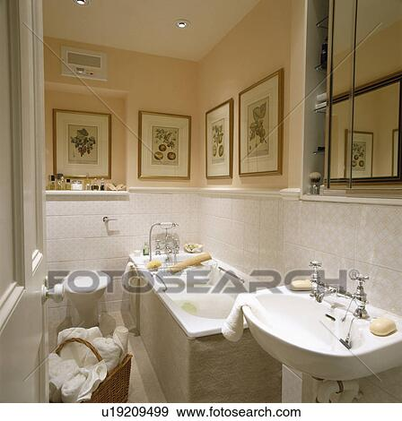 Stock Photograph Of Towels In Basket In Small Peach Bathroom With - Peach towels for small bathroom ideas