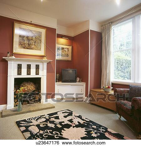 Stock Images Of Patterned Rug In Front Of White Fireplace In Terracotta Living Room With