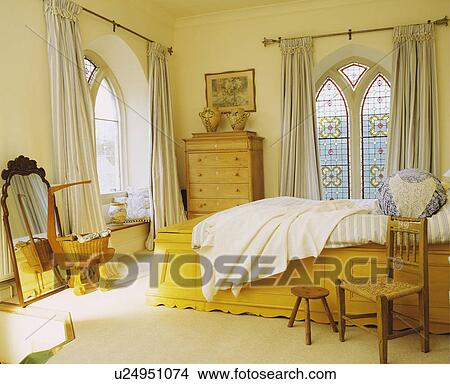 Bedroom Curtains cream bedroom curtains : Stock Photo of Cream curtains at stained glass Gothic windows in ...
