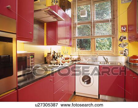 Picture of yellow kitchen with fitted red cupboards and for Red fitted kitchen