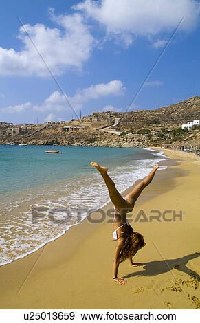 Stock Photograph of woman beach beautiful island mykonos ...