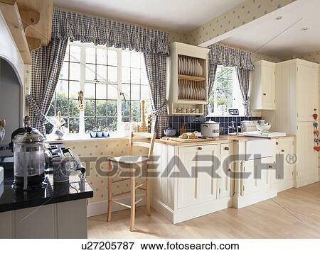 Blue Checked Curtains On Window In Cream Country Kitchen