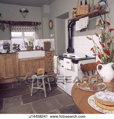 Stock photography of pine table and white aga oven in grey country kitchen with fitted pine - Plancher ardoise cuisine ...