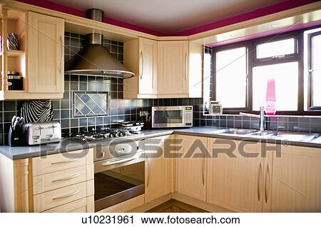 Kitchen Tiles Black Worktop stock photography of black wall tiles above hob and oven in modern