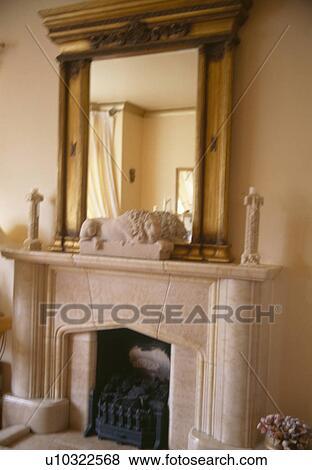 Immagini grande anticaglia doratura specchio sopra for Piccolo caminetto