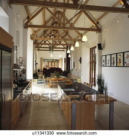 Stock photography of modern kitchen in large open plan barn conversion u11341330 search stock for Barn conversion kitchen designs