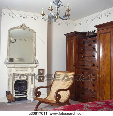 Stock Photography Of Cane Backed Planter S Chair And Large Mahogany Wardrobe In