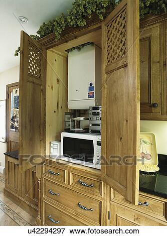 Picture of kitchen cupboard with central heating boiler for Kitchen unit for boiler