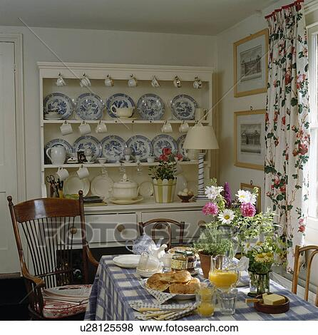 Blue White China On Cream Dresser In Dining Room With Table Set For Breakfast
