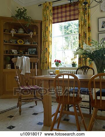Picture Of Checked Blind And Yellow Floral Curtains On