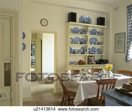 Collection Of Blue White Antique Spode China On Cream Dresser In Dining Room With Table Set For Breakfast