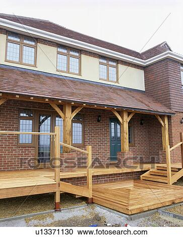 Newly Built Brick House With Wooden Decked Veranda