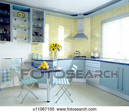 Pale Blue Folding Chairs At Ed Table In Modern Pastel Yellow Kitchen With Units