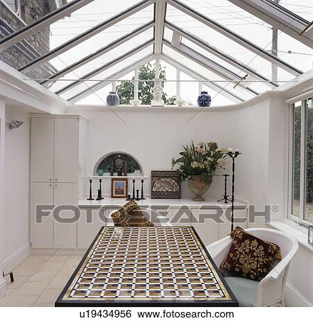 Patterned Table In Modern Dining Room Extension With Glass Roof