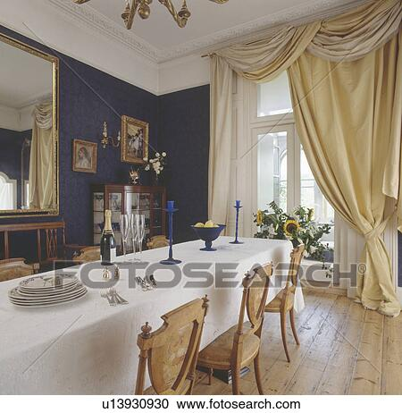 Stock Photography Of Swagged Pastel Yellow Silk Curtains In
