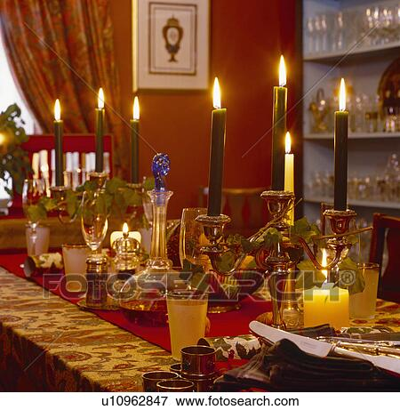 Table Set For Christmas Dinner picture of lighted candles in candelabras and candle-holders on