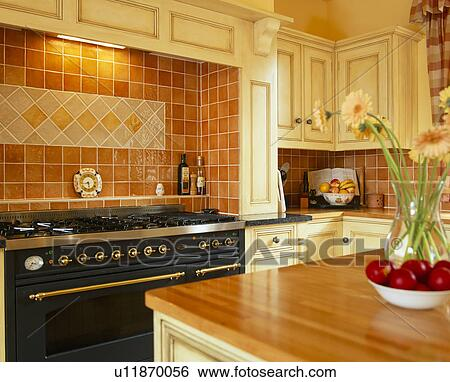 Stock images of terracotta ceramic wall tiles above black for Traditional kitchen wall tiles
