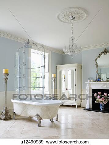 Combined Clawfoot Bath And Shower In Pale Blue Bathroom With White Ceramic  Floor Tiles And Glass Chandelier