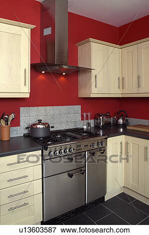 Picture of stainless steel range oven in red kitchen with for Red fitted kitchen