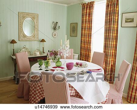 Stock Photograph of Red checked upholstered chairs in pale blue ...