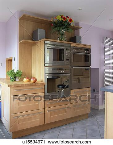 Stock photography of stainless steel double ovens in pale for Mauve kitchen walls