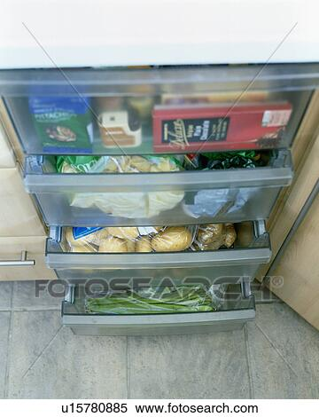 Stock image of close up of perspex vegetable storage for Fitted kitchen drawer unit