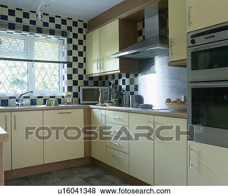 Kitchen Tiles Ideas Pictures Cream Units pictures of cream fitted units and black+cream wall tiles in small