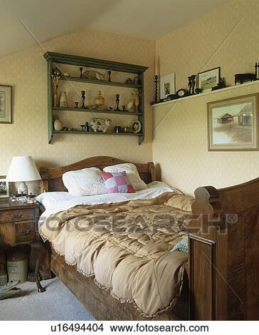 Stock photo of old fashioned eiderdown on mahogany bed for Old fashioned bedroom ideas