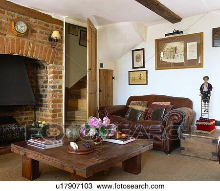 Stock Photo Of Brown Leather Sofa In Cottage Living Room