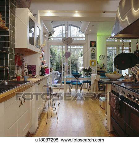 Stock image of wooden flooring in large galley kitchen and for Galley kitchen with dining area