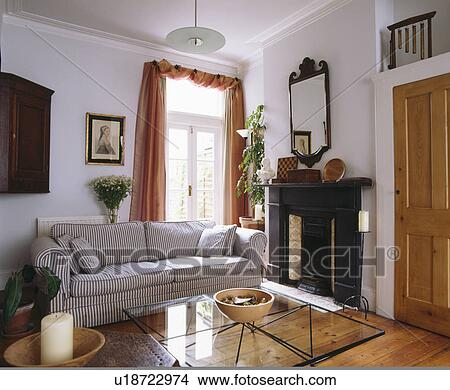 Stock Photo Of Striped Sofa In Modern White Living Room With Peach Curtains At Window U18722974