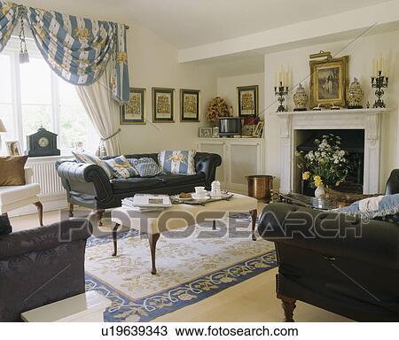 Stock foto leder chesterfield sofas in wei - Chesterfield wohnzimmer ...