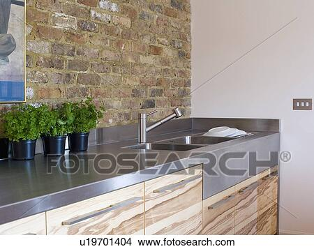 Stock photo of exposed brick wall above stainless steel for Exposed brick wall mural