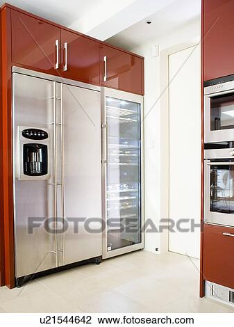 Stock photo of large stainless steel fridge freezer with for Tall fitted kitchen unit