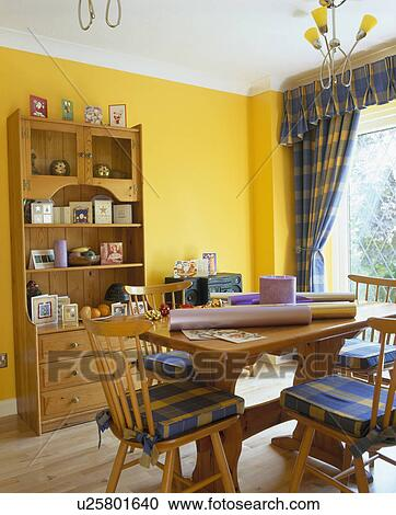 Pine Tble And Dresser In Yellow Eighties Style Dining Room With Blue Checked Curtains