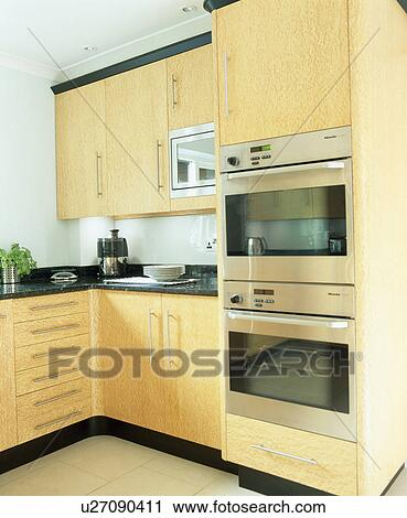 stock photography of eye level double oven in modern. Black Bedroom Furniture Sets. Home Design Ideas