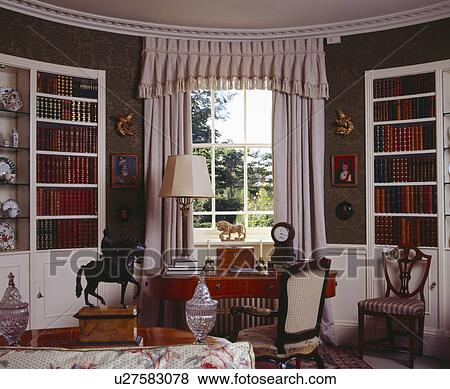 Pictures of Cream curtains at tall window between alcoves shelves ...