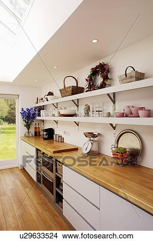 White Kitchen Units Wood Worktop stock photo of wooden worktop on white fitted unit below shelves