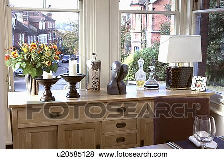 White Lamp And Candles On Fitted Sideboard In Front Of Window Townhouse Dining Room