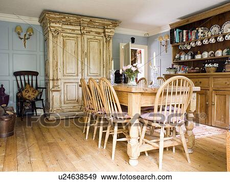 Fabulous Stock Photograph Windsor Chairs And Wooden Table In Pale Blue  Country Dining Room With Large With Blue Windsor Chairs